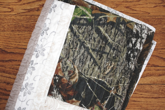 folded camouflage quilt