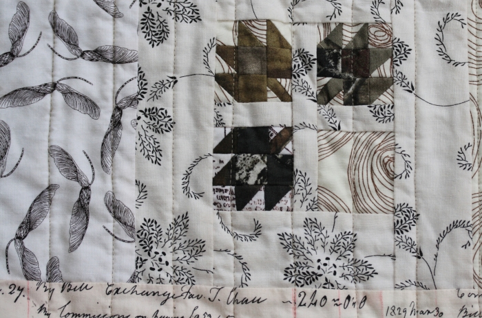 maple seeds and leaves on camouflage quilt