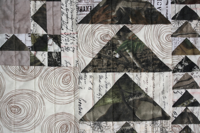 realtree logo on camouflage quilt