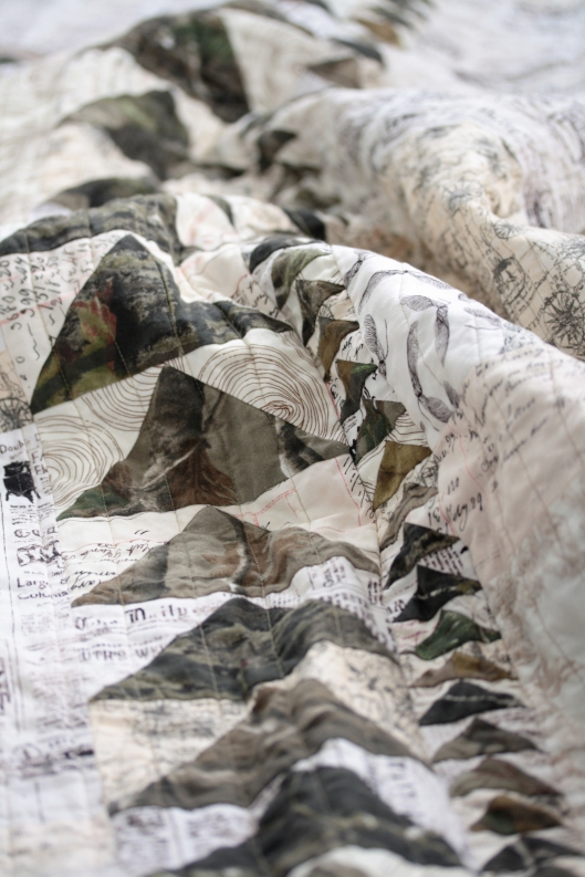 row of geese on camouflage quilt