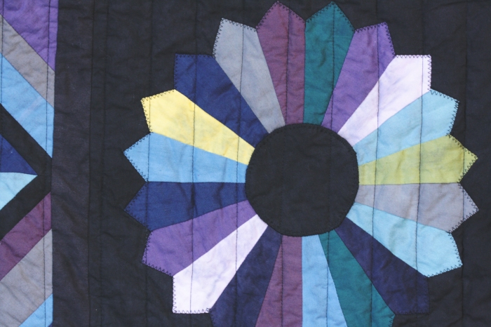 dresden plate on black and color quilt