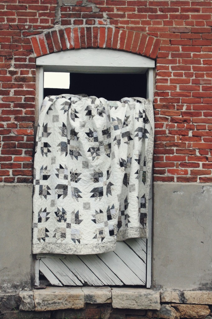 scrappy bear paw quilt on door
